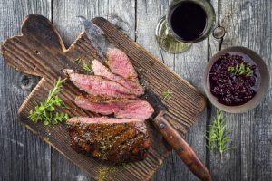 venison steak on a cutting board